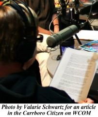 Jackie Helvey behind the microphone photo by Valarie Schwartz for an article in the Carrboro Citizen